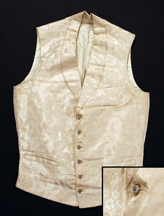 Waistcoat with similar type of glass button embellishment but with flower inset, not a swirled inset (c. 1860s)